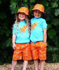 Reversible orange rocket boys girls shorts