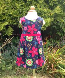 Reversible floral raspberry red corduroy dress