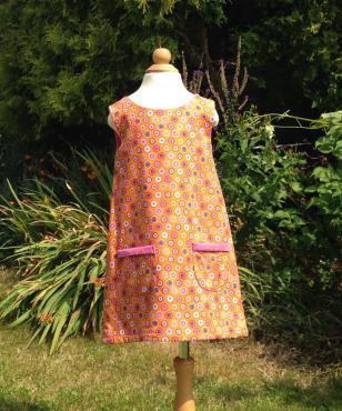 Reversible orange pink corduroy dress