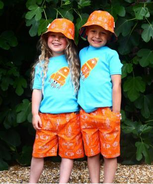Reversible orange rocket boys girls shorts