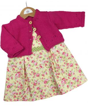 girls cotton yellow pinafore dress with pink roses and green polka dot waistband with pink cotton cardigan