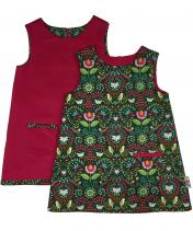 Reversible A-line girls pinafore colourful print with monkeys and parrots on emerald green cotton and a pink corduroy dress reverse